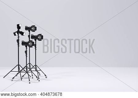 Photography Studio Flash On A Lighting Stand On White Background
