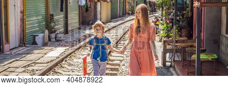 Banner, Long Format Mother And Son Travelers Walk Around Railway Paths Which Go Through Residential