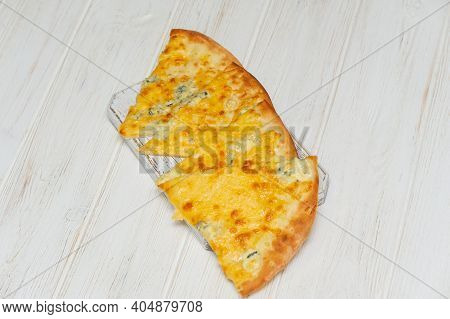 Delicious Italian Pizza On A White Wooden Background. Pizza. Lunch