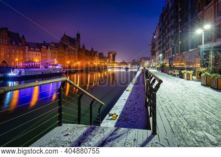 Snowy scenery of Gdansk over Motlawa river at dawn, Poland.