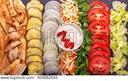 Ingredients For Popular Arabic Turkish Fastfood Doner Shawarma Roll With Meat And Vegetables On Blac