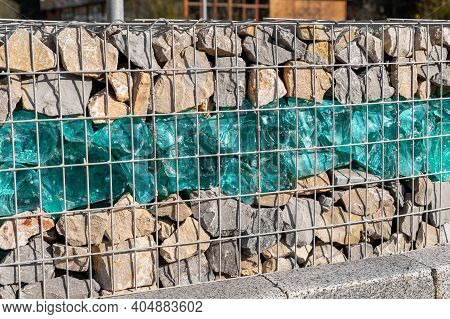 Close-up Detail Of New Modern Beautiful Gabion Fence With Metal Cage Filled By Crushed Stone And Sha