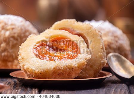 Austrian And Czech Sweet Dessert Knedle Apricot Dumplings On Wooden Background. Filled Cottage Chees