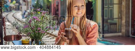 Banner, Long Format Young Woman Traveler Drinks Coffee Sitting By The Railway Paths Which Go Through