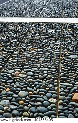 Wall Texture Decorated With Blue Pebbles, Pebbles Glued To The Wall, Background Pebble Wall Texture