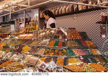 Barcelona, Spain - May 10, 2017: This Is A Spices And Dried Fruits Stall With Unidentified Saleswoma