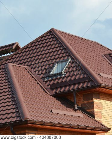 A Close-up Of A Metal Roofing Waterproofing Problem Area With Roof Flashings, A Complex Roof With Va