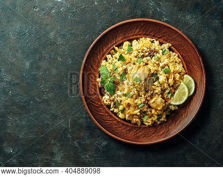 Pakistani Food - Biryani Rice With Chicken On Plate. Delicious Hyberabadi Chicken Biryani On Dark Ba