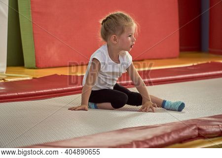 A Girl Gymnast Plays In A Multi-colored Gymnastic Sponge Cube. Children Sport