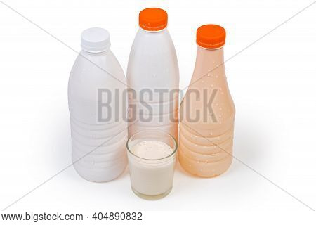 Plastic Bottles And Glass Of The Various Drinkable Fermented Dairy Products On A White Background