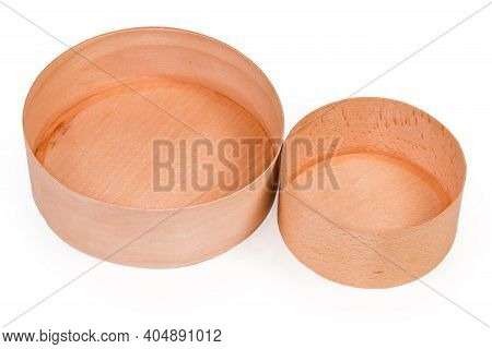 Two Empty Small Round Boxes Different Size Without Lids, Made With Beech Wood On A White Background