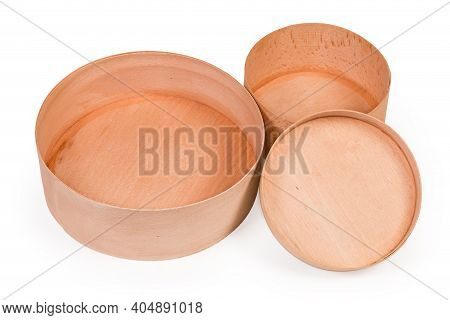 Two Empty Small Round Boxes Different Size With Removed Lids, Made With Beech Wood On A White Backgr