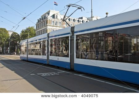Tram running in Amsterdam citycenter in the Netherlands