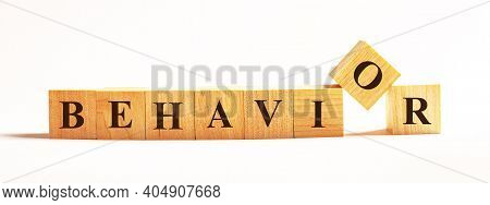On A Light Background, Wooden Cubes With The Text Behavior
