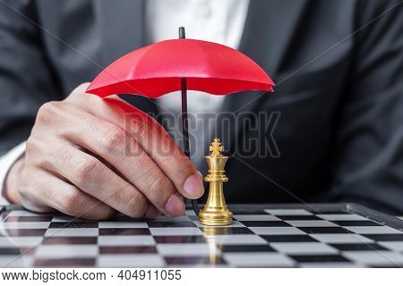 Business Man Hand Holding Red Umbrella Cover Chess King Figure. Business, Risk Management, Solution,