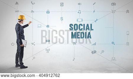 Engineer working on a new social media platform with SOCIAL MEDIA inscription concept