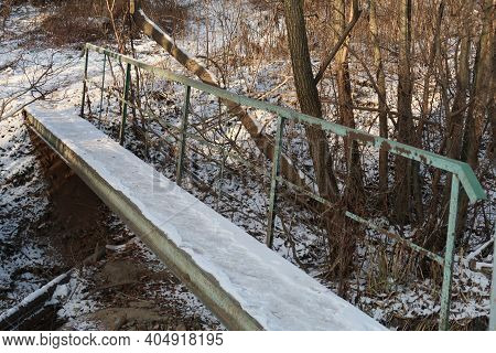 Concrete Footbridge With Green Rusty Metal Railings, Forest