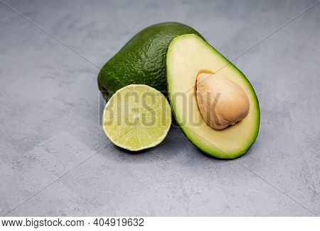 Food Background With Fresh Organic Avocado, Lime. Fresh Green Food Selection For Detox Diet. Ingredi