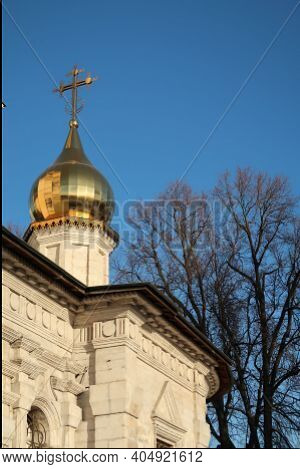 Gilded Dome And Cross Of A White-stone Church Against A Blue Sky, Moscow Region