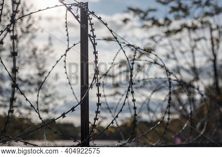 Barbed Wire On The Fence. The Concept Of Prison, Rescue, Refugee, Solitude.