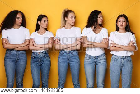 Offended Discontented Multiracial Ladies Looking At Asian Female Friend Unfriendly Disapproving Her