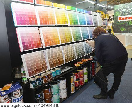 Kyiv, Ukraine - March, 26, 2020: A Customer Is Choosing The Right Interior Paint Color Using The Pai