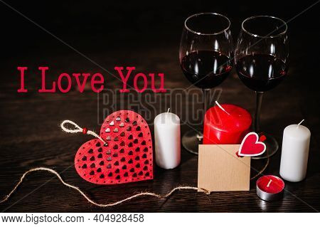 Text I Love You. Blank, Craft Paper, Candle, Red Heart, Wine On Brown Wooden Background With Space.
