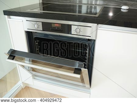 A Close-up On A Black Radiant Electric Cooktop, Electric Ceramic Glass Top Stove With A Built-in Ele