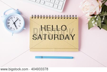 The Notepad With The Text Hello Saturday Is On Colored Paper With Color Pencils. Concept Photo
