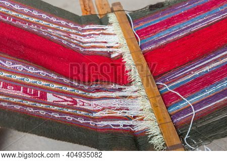 Closeup Of Some Colorful Fabrics Made By Local Peruvian Women Using An Old Loom At Chinchero In Sacr