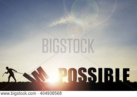 Mindset Concept ,silhouette Man Pulling  Impossible To Change Possible Wording On Cloud Sky And Sunl