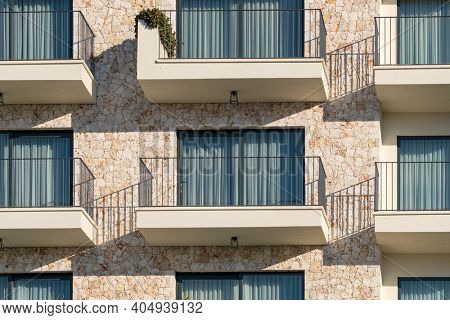 New modern architectural building house. Exterior of modern residential apartments building with balconies. Detail of new luxury house and home complex.