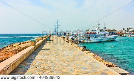 Aya Napa, Cyprus - January 24, 2019: Long pier in the port of Ayia Napa (Agia Napa)