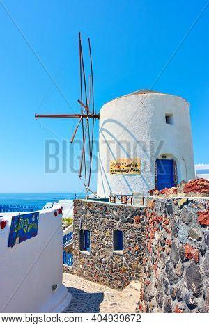 Oia, Santorini, Greece - April 24, 2018: Traditional white windmill in Oia in Santorini