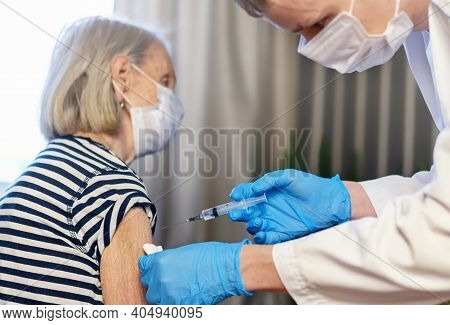 85-year-old Woman Receives The Covid-19 Vaccine From A Doctor At Home. Vaccination Of The Elderly. A