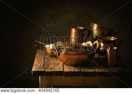 Vintage Copper Dishes, Pots And Pans On Dark Wooden Background