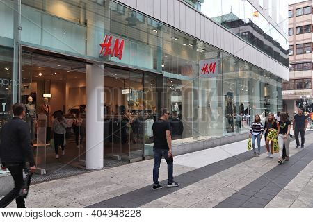 Stockholm, Sweden - August 23, 2018: People Walk By H And M (h&m) Fashion Store In Stockholm, Sweden