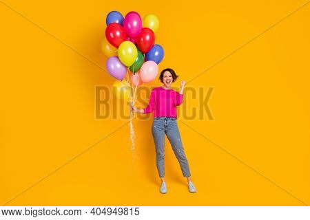 Full Size Photo Of Ecstatic Girl Hold Balloons Win Raise Fists Wear Pullover Isolated Bright Color B