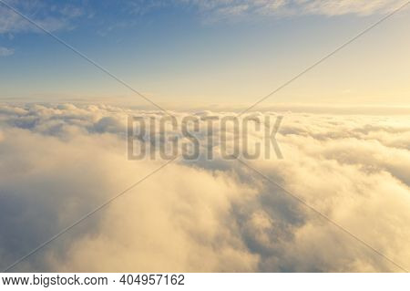 Aerial View White Clouds In Blue Sky. Aerial Top View Cloudscape. Texture Of Clouds. View From Above