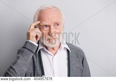 Portrait Of Old White Hair Think Man Look Empty Space Finger Forehead Wear Dark Sweater Isolated On