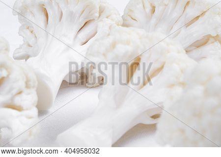 Pieces Of  Cauliflower Isolated On White Background. Fresh Cauliflower Vegetable Isolated. Ripe Caul