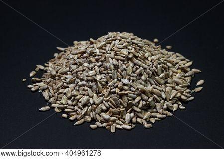 Peeled Sunflower Seeds On A Black Background. Sunflower Seeds. Seeds Without Husks. Pile Of Sunflowe