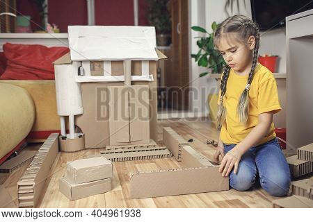 Zero Waste Home Activity. Kids Doing Paper House With Cardboard Box, Creatively Thinking Concept