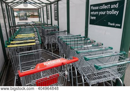 Rhyl; Uk: Jan 01, 2021: A Trolley From An Iceland Supermarket Has Been Placed In A Trolley Shelter A