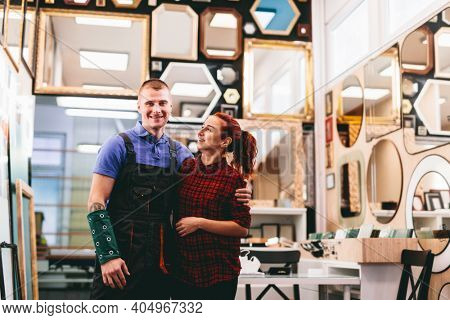 Small business owners portrait. A local mirror shop with handmade frames