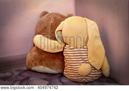 The Teddy Bear And Bunny Are Sitting In The Corner, With Their Backs To Us. Cruel Treatment Of Child