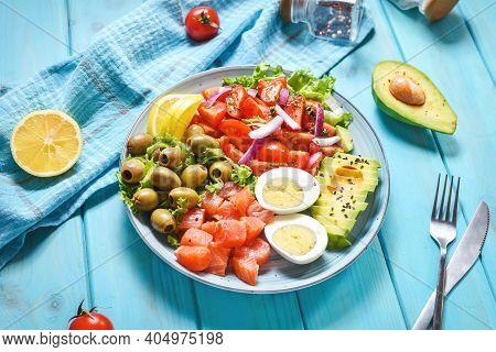 Ketogenic, Paleo Diet Lunch Bowl With Salted Salmon Fish, Lemon, Avocado, Olives, Boiled Egg, Tomato