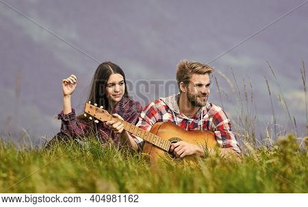 Romantic Mood. Couple In Love Enjoying View From Top Of Mountain. Boyfriend Playing Guitar. Singing