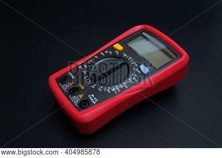 Red Digital Multimeter On Black Background - Multimeter Is An Electronic Measuring Instrument For Vo