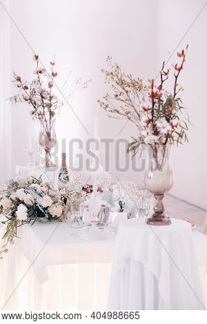 Wedding Table Decoration With Flowers On The Table In Winter Style,